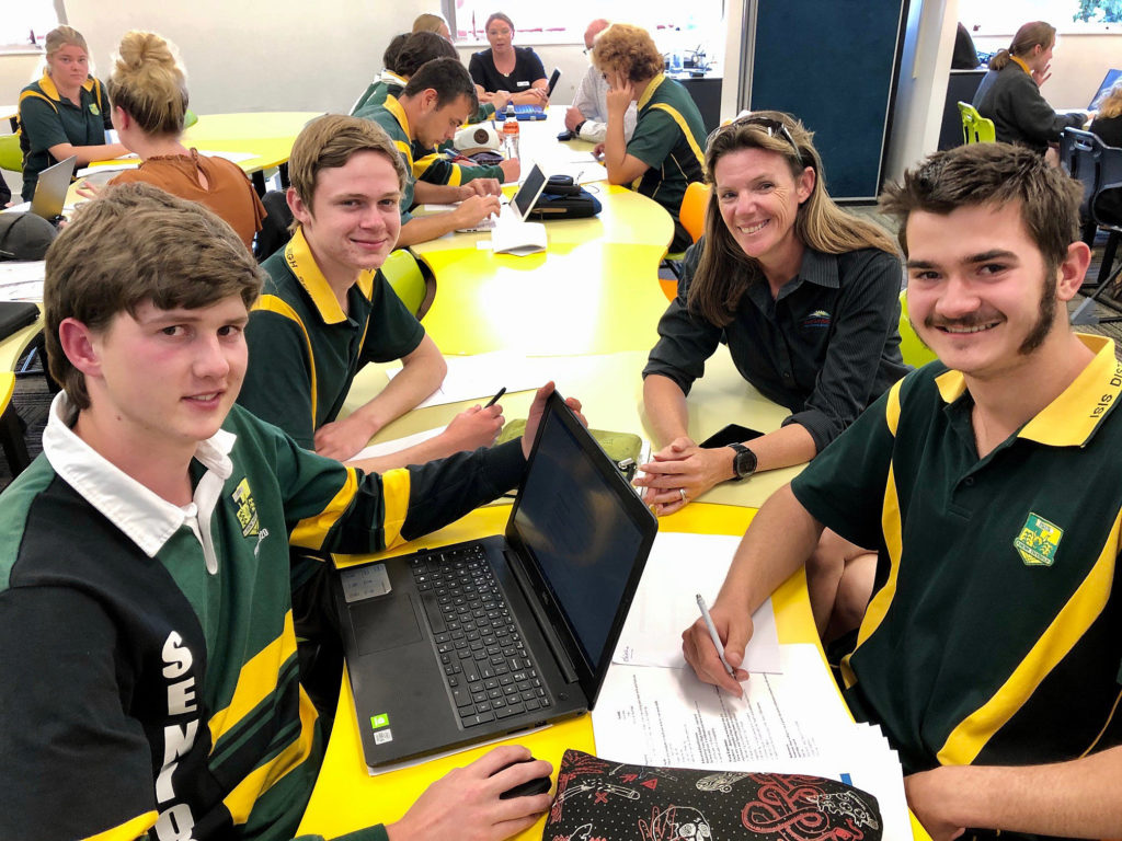 Community Resilience Coordinator Andrea Bax discusses successful resume writing with Isis High students (from left) Kurt Mackay, Lawson Bounds and Maverick Ashcroft.
