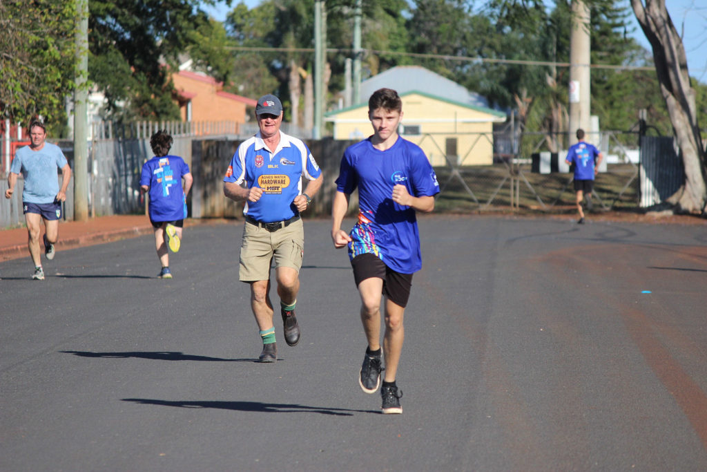 Age shall not weary them! Putting in the long strides is Officer-in-Charge of Childers Police Sergeant Geoff Fay as he chases home one of the participants in the Blue Edge program.