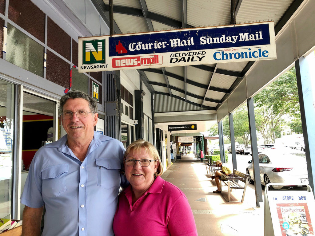 Graham and Joanne Walker with a sign of the times. Once printed newspapers were the hub of their newsagency business.
