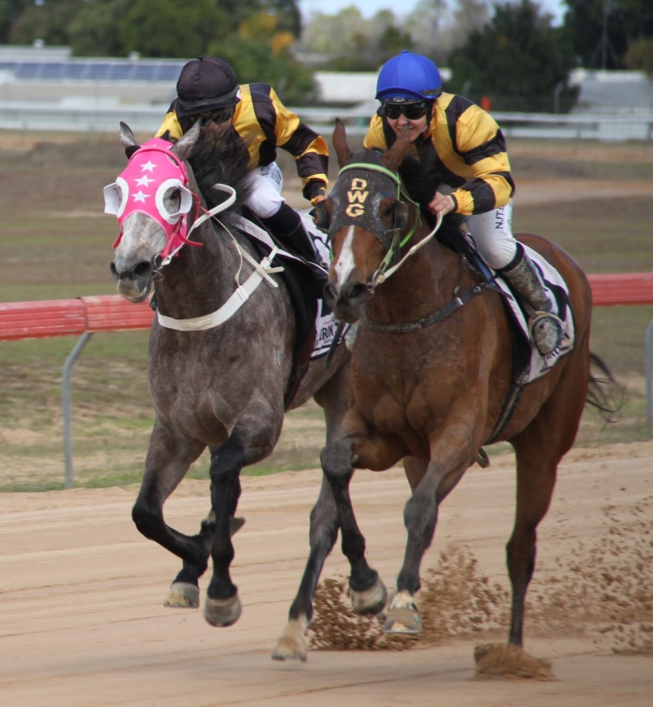 Apprentice Rebecca Wilson rides Dolci (right) to edge out Shenzi (Hannah Richardson) in the Class B Handicap.