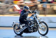 Flame Howard on her Harley headed for another slick time at Benaraby Dragway.