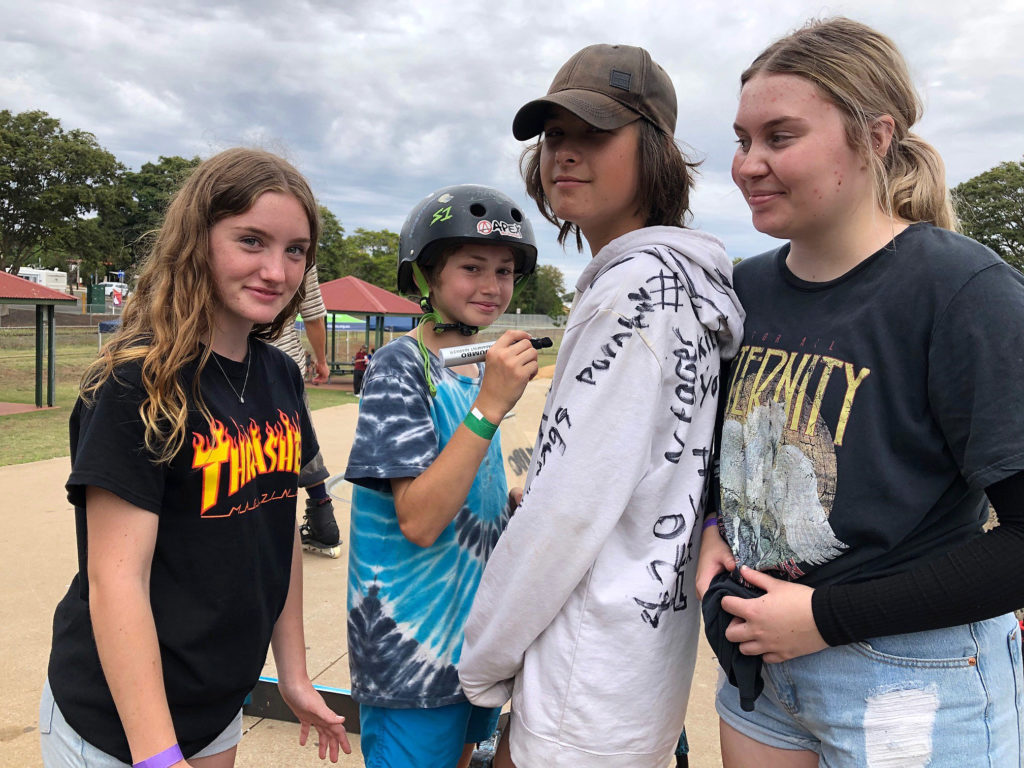 Autographing Ashlan Cutting's hoodie at the Childers Skatepark are (from left) Jazmyn West, Cody Nibbs and Alyssa Priestley.