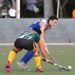 Waves Cities' Sarah Quaite jostles for the ball with Raiders/Rovers' Alana McManus in the women's grand final.