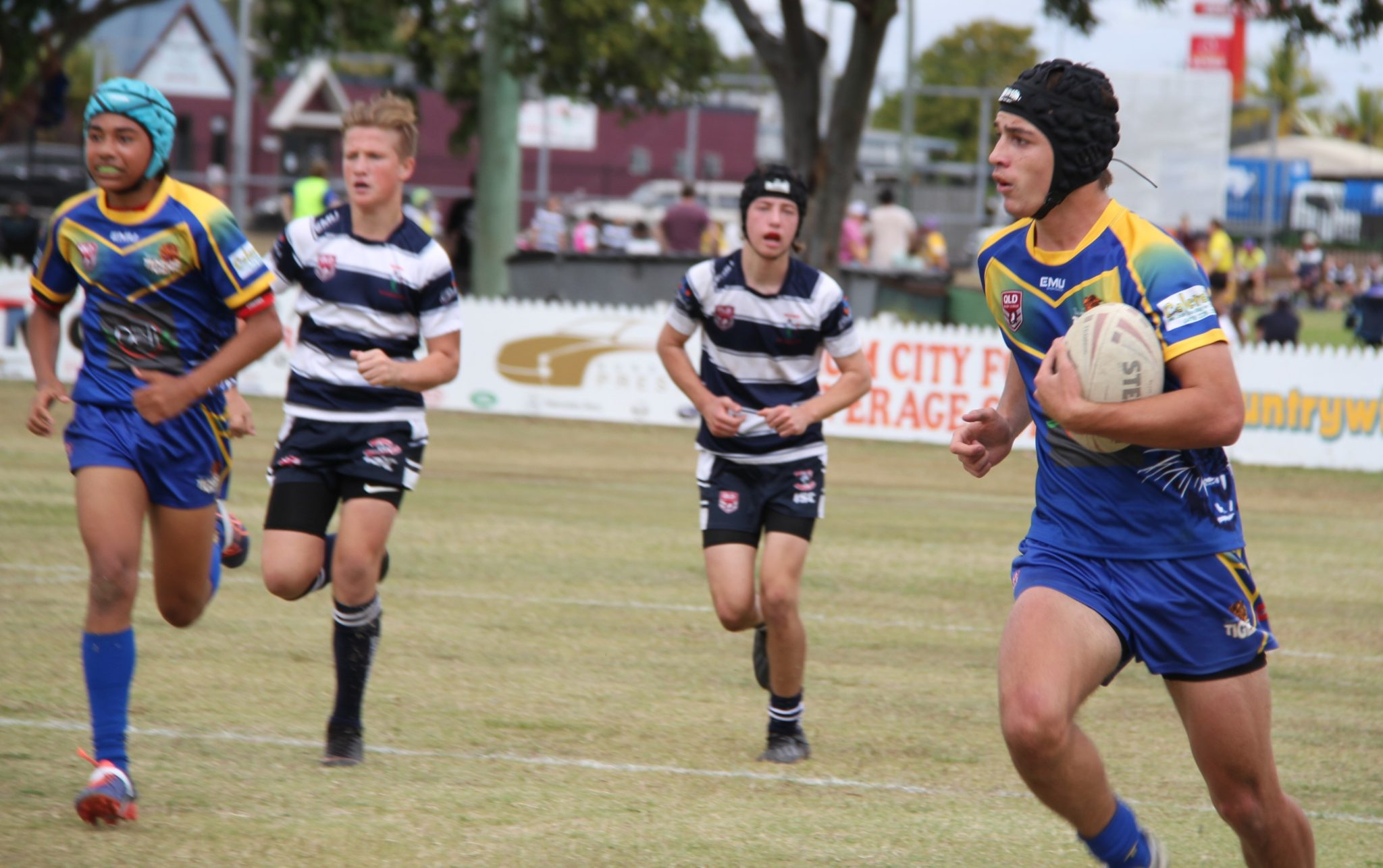 Tom Morcom makes another attacking raid for Waves Tigers in their under-14 showdown with Brothers