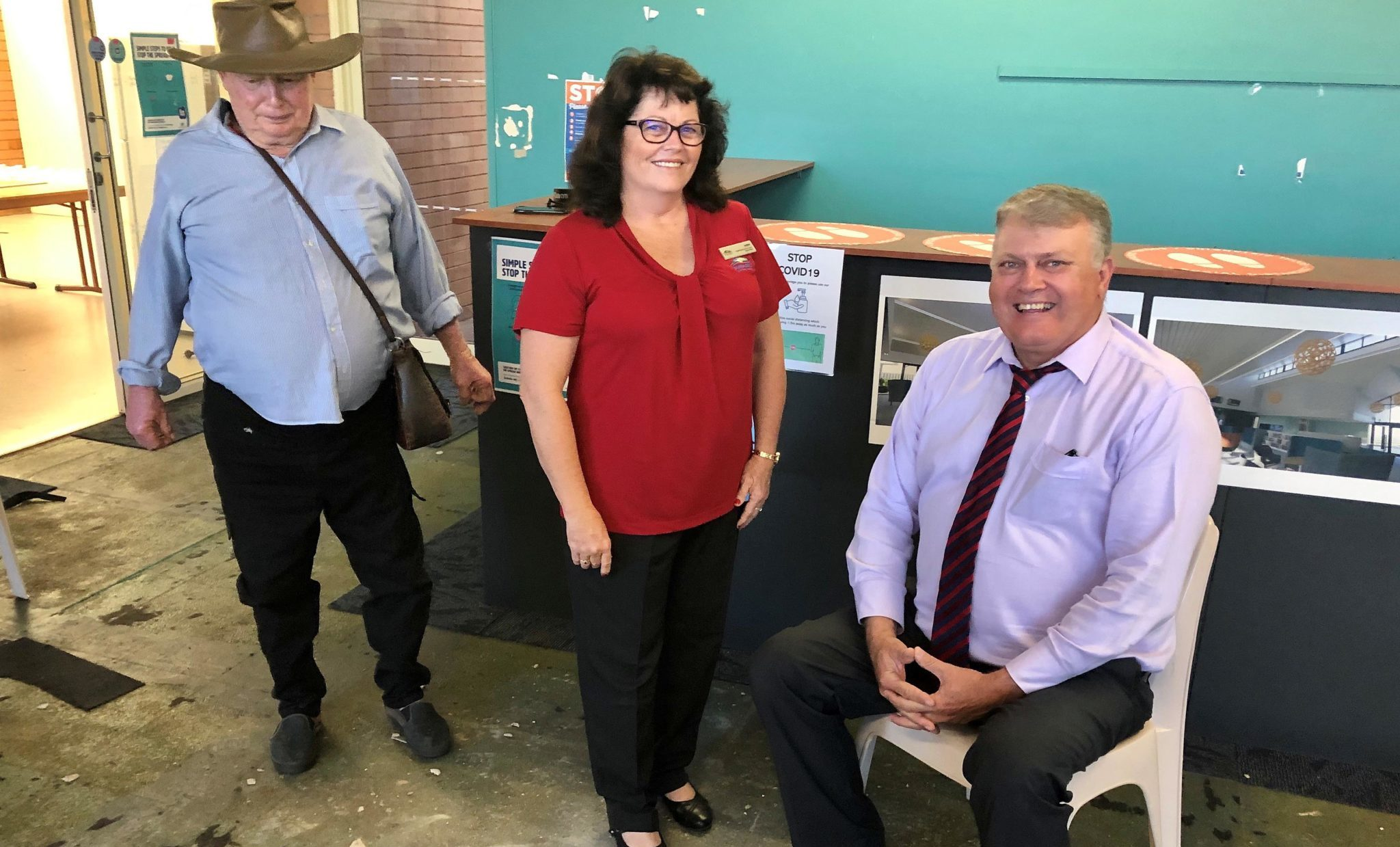 Retrieving the Kolan Centenary Time Capsule from the floor of the former Gin Gin Neighbourhood Centre brought back memories for (from left) Herb Aulfrey, Amber Larsen and Cr Wayne Honor. The capsule will be secured for a further 59 years.