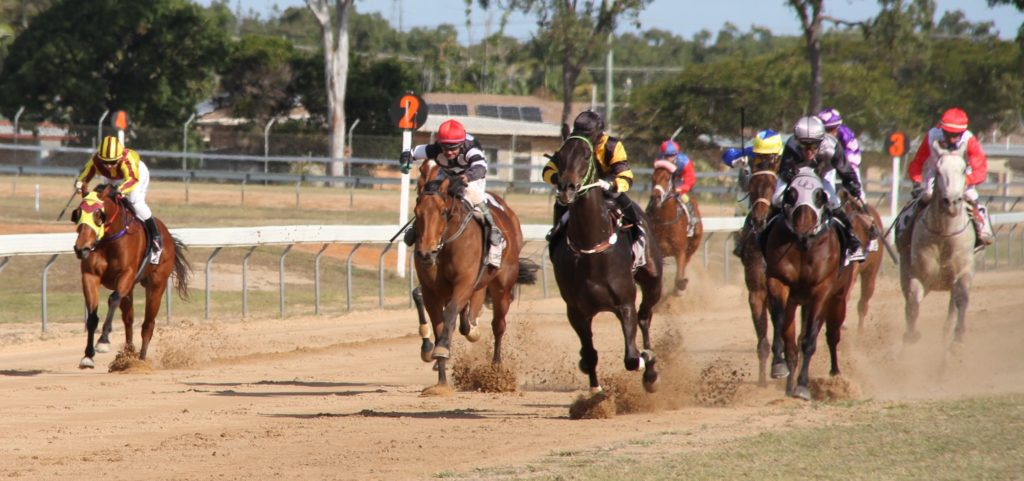 Wrecking Ball (centre in gold and black colours), ridden by Hannah Richardson races to the front on the way to winning the Benchmark 55 Handicap.