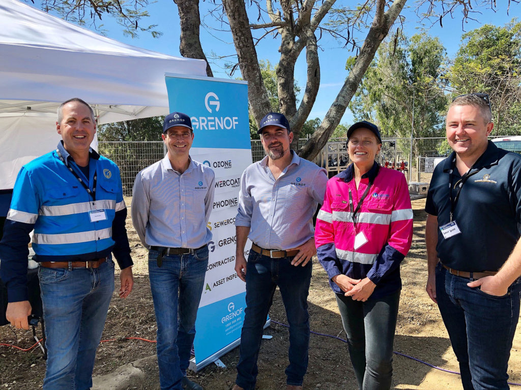 Grenof, one of the companies displaying product at the Bioeconomy Bundaberg 2020 conference attracted the interest of (from left) Oreco Group Director Paul Woosley and (at right) Fiona Waterhouse (Utilitas) and Damian Botha (Greensills Farms). Grenof Managing Director Scott Barnes and General Manager Luke Sirl were promoting their product which neutralises sewerage odour.