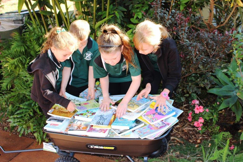 Students enjoy a look at the new books donated to Childers State School by Ergon and Dymocks