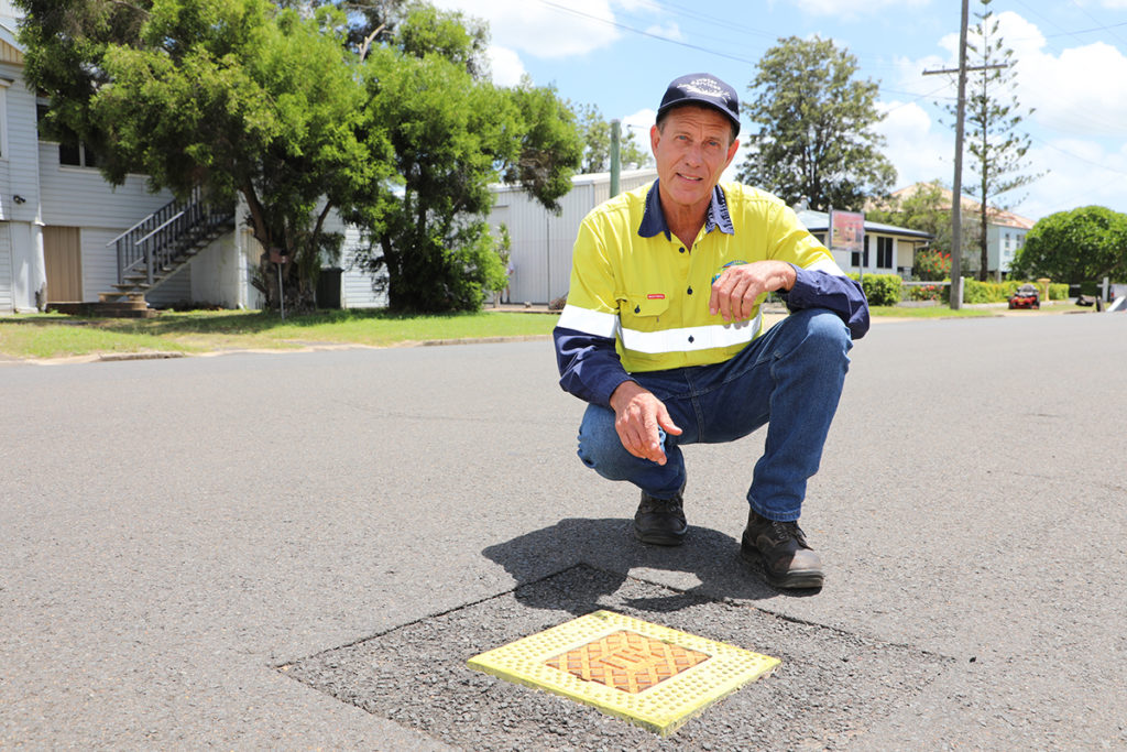 Bundaberg Regional Council's Ian Laing with a water hydrant.
